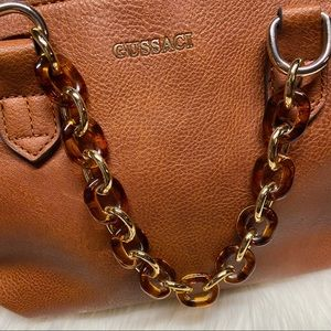 Vegan leather with tortoise shell chain handles